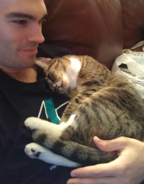 cat_curled_on_scott